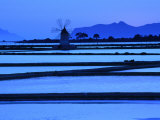 Windmill and Surrounding Saltpans on the Island of San Pantaleo, Sicily, Italy Photographic Print by Dallas Stribley
