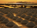 Sun Setting Over Mounds of Salt Drying on Saltpans, Mothia, San Pantaleo, Sicily, Italy Photographic Print by Dallas Stribley