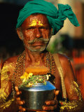 Pilgrim with Offerings to Give to Deities at Sri Meenakshi Temple, Madurai, India Photographic Print by Paul Beinssen