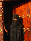 Woman in Bui-Bui Standing in Zanzibar Doorway, Looking at Camera, Lamu, Kenya Photographic Print by Ariadne Van Zandbergen