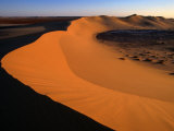 A Sand Dune Rises Out of the Sahara Desert, Ghadhames, Libya Photographic Print by Doug McKinlay