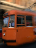 Orange Tram Moving, Naples, Italy Photographic Print by Martin Moos