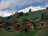Wooden Chalets on Slope with Snow-Capped Peaks in the Background, Rougemont, Switzerland Photographic Print by Martin Moos