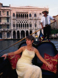 Woman in Gondola in Front of Ca'D'Oro in Grand Canal, Venice, Veneto, Italy Photographic Print by Roberto Gerometta
