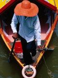 Helmsman Manoeuvres Sampan or Ferry on Sarawak River, Kuching, Sarawak, Malaysia Photographic Print by Mark Daffey