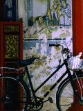 Bicycle Against Muralled Wall of Chinese Temple at Marudi, Sarawak, Malaysia Photographie par Mark Daffey