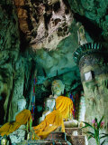 Seated Buddha Statues in Saffron Cloth Inside Cave, Chiang Dao, Thailand Photographic Print by Ryan Fox