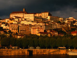 Dark Clouds at Sunset Hang Over the Velha Universidade (Old University) of Coimbra, Portugal Photographic Print by Anders Blomqvist