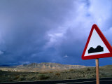 Road Sign Indicating Hilly Terrain, Isla De Fuerteventura, Canary Islands, Spain Photographic Print by Martin Lladó