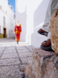 Woman Approaching Man Sitting on Step in Lane, Nerja, Spain Photographic Print by Philip & Karen Smith