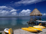 Kayaks for Rent on the Shores of Lake Peten Itza Near Tikal, El Peten, Guatemala Photographic Print by Greg Johnston