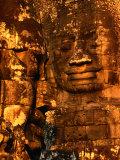 Smiling Lokesvara Bodhisattva Image Adorning the Bayon Temple of Angkor Thom, Angkor, Cambodia Photographic Print by John Banagan
