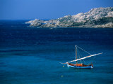 Traditional Sailboat on Rocky Coast of Island, Sassari, Maddalena, Sardinia, Italy Photographic Print by Dallas Stribley