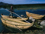 Aymara Boy on Reed Boat on Lake, Lake Titicaca, Puno, Peru Photographic Print by Eric Wheater