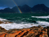 Rainbow Dipping into Coles Bay During Stormy Weather, Freycinet National Park, Tasmania, Australia Lámina fotográfica por Grant Dixon