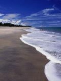 Distant Couple Walking on Beach, Santa Clara, Panama Photographic Print by Alfredo Maiquez
