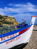 Traditional Painted Fishing Boat on Beach, Albufeira, Algarve, Portugal, Photographic Print by Roberto Gerometta