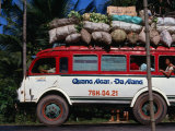 Bus Carrying Load and Passengers, Vietnam Fotografie-Druck von John Borthwick