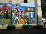 Woman Leaning Against a Wall with Mural in Old Havana, Havana, Cuba Photographic Print by Rick Gerharter