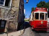 Tram Travelling Through Alfama, Central Lisbon, Lisbon, Portugal Photographic Print by Damien Simonis