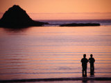Two People Silhouetted in Sunset Over Sea, Sunset Bay State Park, USA Photographic Print by Ryan Fox