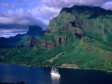 A Sailboat Cruises Past Mountainous Shoreline, Moorea, Society Islands, The, French Polynesia Photographic Print by Peter Hendrie