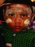 Boy with Paste of Thanakha Tree Bark on Face, Looking at Camera, Myanmar (Burma) Photographic Print by Frank Carter