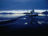 Fishing Boat Plowing Through Calm Waters Outside of Lofoten, Lofoten, Nordland, Norway Photographic Print by Christian Aslund