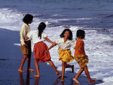Girls on Lebih Beach, South of Gianyar, Play along the Fringe of Breaking Waves, Indonesia Photographic Print by Adams Gregory