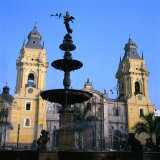 The San Francisco Monastery and Bronze Statue on Plaza De Armas in Lima, Peru Photographic Print by Wes Walker