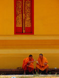 Two Monks Talking, Vientiane, Laos Photographic Print by Frank Carter