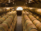 Oak Barrels in Wine Cellar at Groth Winery in Napa Valley, California, USA Photographic Print by Julie Eggers