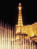 Paris Hotel and Casino's Eiffel Tower with the Bellagio Water Fountain Show, Las Vegas, Nevada, USA Photographic Print by Brent Bergherm