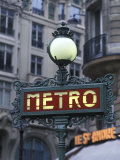 Metro Signage in Paris, France Photographic Print by Bill Bachmann