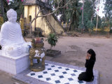 Woman Praying to Buddha, Vinh Trang Pagoda, My Tho City, Vietnam Photographic Print by Bill Bachmann