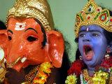 A Child Dressed as Hindu God Krishna Yawns, Chennai, India, September 22, 2006 Photographic Print by M. Lakshman