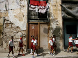 Cuban Students Walk Along a Street in Old Havana, Cuba, Monday, October 9, 2006 Photographic Print by Javier Galeano