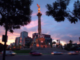 Traffic Passes by the Angel of Independence Monument in the Heart of Mexico City Photographic Print by John Moore