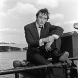 Terrence Stamp Sitting on Railing Beside the River Thames, September 1962 Photographic Print