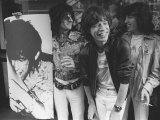 Rolling Stones Bill Wyman, Mick Jagger and Ronnie Woods Stand Beside Poster of Keith Richards Photographic Print