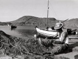 Fisherman Tends to His Nets in Greece Photographic Print