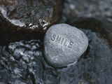 Rock with the Word Smile in Rushing Water Photographic Print