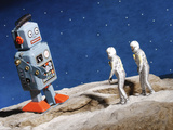Astronaut Figurines Standing Beside Gray Toy Rocket Photographic Print
