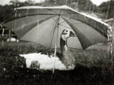 A Goose Takes Cover from the Heavy Rainfall Underneath an Umbrella, Dorset, October 1968 Photographic Print