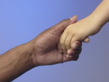 Adult Holding Child's Hand Photographic Print