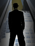 Man in Suit and Bowler Hat Standing in Front of Skyscraper Photographic Print
