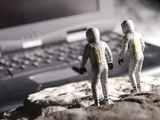 Model Astronauts Looking at Giant Laptop Computer on the Moon Photographic Print