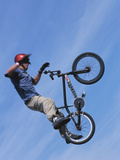Man Performing Trick on a Bicycle Photographic Print