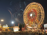 Spinning Ferris Wheel at Night Photographic Print