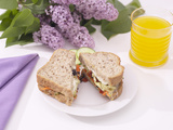 Sandwich and Juice on Table with Purple Flowers Photographic Print